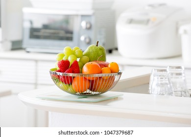 Fruit basket in bright kitchen