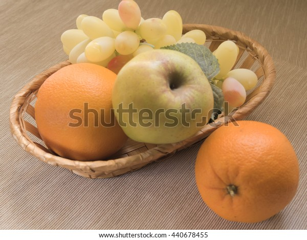 fruit basket on wooden background. Retro processing