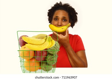 Fruit basket Woman with banana smile looking at camera