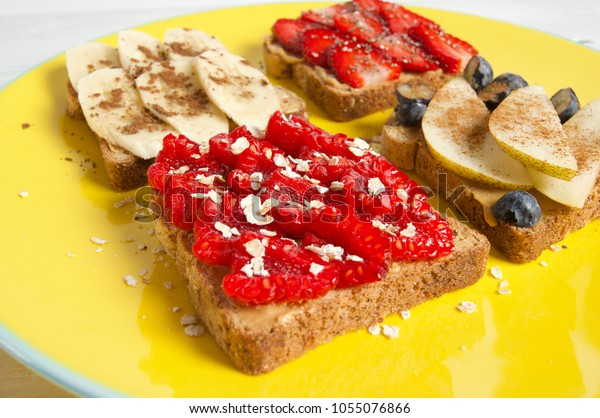 Fruit, berry and peanut butter sandwich