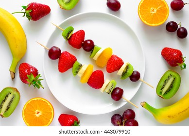 Fruit and berry skewers concept, simple healthy raw meal and ingredients, good for kids party, top view