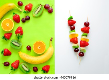 Fruit and berry skewers concept, simple healthy raw meal and ingredients, top view