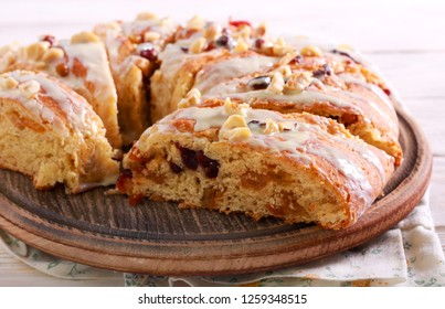 Fruit bread with icing, sliced on board