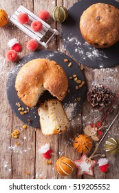 fruit bread panettone and christmas decoration close-up on the table. vertical view from above