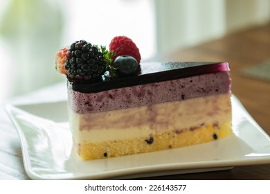 fruit cake with berries on white plate