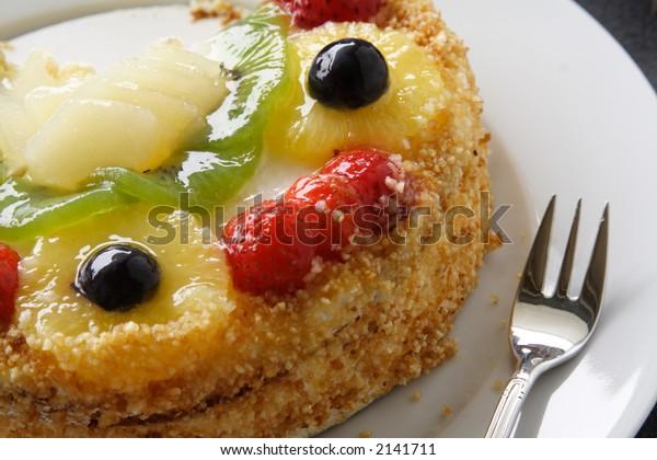 Fruit Cake with Fork for tasting