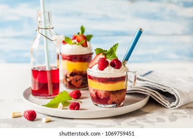 Fruit Cake, Jelly, Custard, Berry and White Cocolate Whipped Cream Individual Trifles, copy space for your text