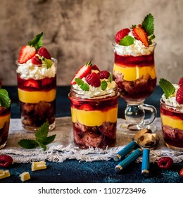 Fruit Cake, Jelly, Custard, Berry and White Cocolate Whipped Cream Individual Trifles, square