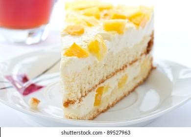 fruit cake with milk cream and fruit