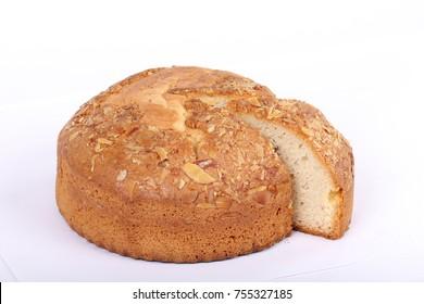 fruit cake on white background, round fruit cake with slices