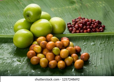 Fruit : Close up of  Different Varieties of Indian Jujube Apple Isolated on Green Banana Leaf Background Shot in Studio