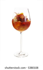 Fruit cocktail in red wine glass over a white background (isolated)