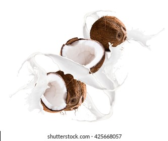 Fruit, coconut in milk splash, isolated on white background