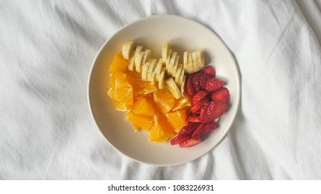 Fruit dish on white bed
