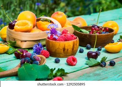 Fruit in drops of water. Fruits. Fruit background. Cherries, cherries, raspberries, apricots, blueberries, strawberries, currants,