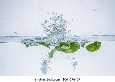 Fruit falling into the water. Fying bunches. Aqua shooting.