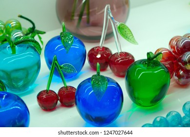 fruit figures made of glass.  Colored glass ornaments. glass blowing technique,