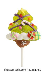 A fruit flavored xmas tree lollipop treat on a stick.