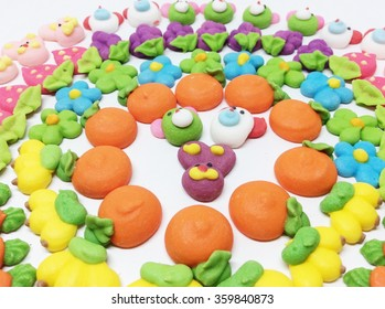 Fruit and flower made of colored sugar isolated on white