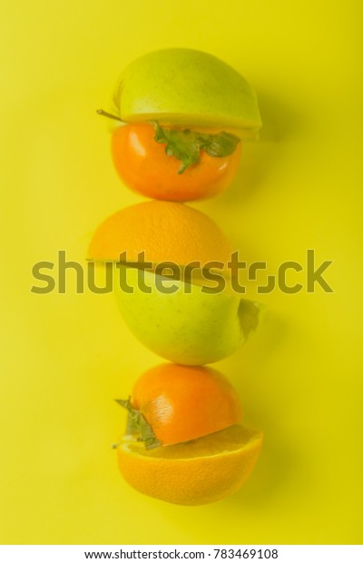 fruit halfs persimon orange apple fruits background