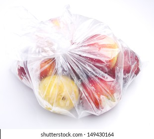 fruit into a plastic bag