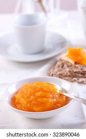 Fruit jam with pumpkin and on white background