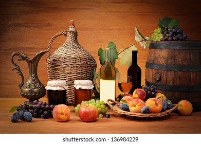 Fruit, jam and wine bottles on the table