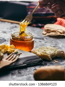 Fruit jams and marmalades with various cheeses on a plate. Breakfast with coffee and cheese