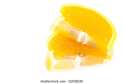 fruit jellies. Jelly candies and fresh citrus in form lobules isolated on a white background