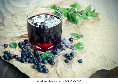 Fruit juice with forest fruit - aronia-berry and blueberry (healthy drink - beverage)
