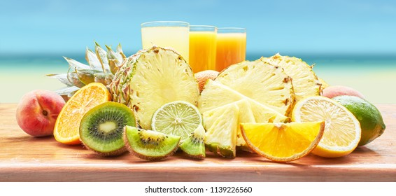 Fruit and fruit juices on background sea.