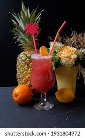 Fruit kisses rum in paradise. tasty and fruity cocktails served in glasses