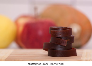 Fruit leather rolls on the board. Healthy and organic snack.