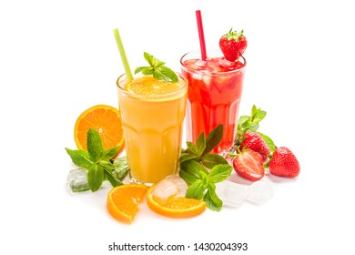 Fruit lemonade in a glass with a straw. Multicolored Cocktails of strawberries and oranges with the addition of mint and ice cubes