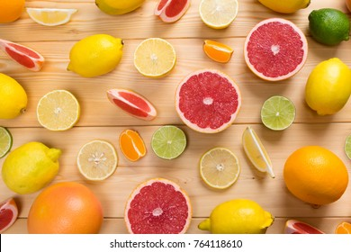 fruit lime, lemon, and grapefruit with vitamin C chopped, lie on a wooden background