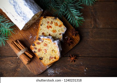 Fruit Loaf Cake Dusted with Icing Sugar, Christmas and Winter Holidays Treat, Homemade Cake with Raisins on Wooden Background