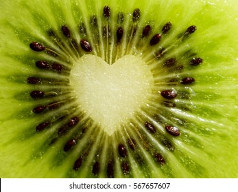 Fruit Love / Closeup of kiwi with heart in the middle.