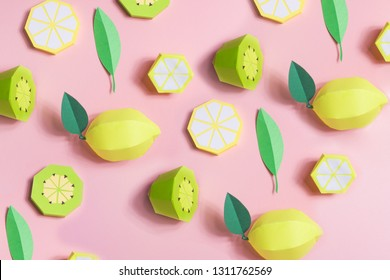 Fruit made of paper. Pink background. There's room for writing. Tropics. Flat lay. Kiwi, lemon.
