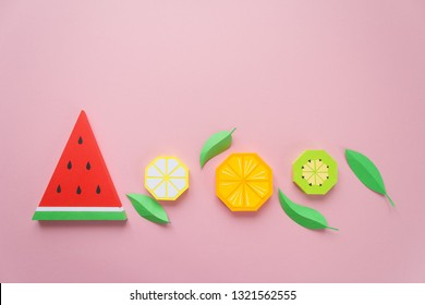 Fruit made of paper. Pink background. There's room for writing. Tropics. Flat lay.