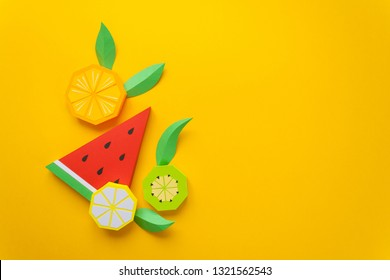 Fruit made of paper. Yellow background. There's room for writing. Tropics. Flat lay.