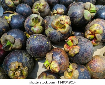 The fruit of the mangosteen is sweet and tangy