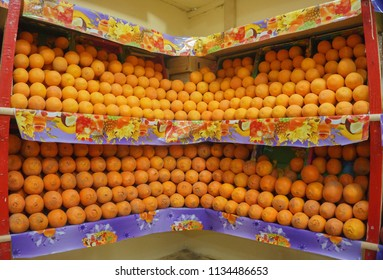 Fruit market with orange. Fresh fruits on the shelf in the store. Perfectionism concept.