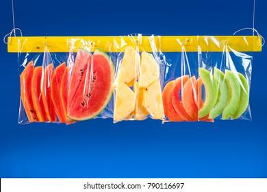 Fruit mix in plastic bags.