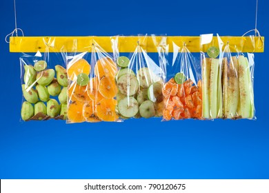 Fruit mix in plastic bags for sale.