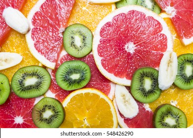 Fruit Mixture. Top View Grep, Oranges, Kiwi and Banana Slices. Colorful Fresh Food Background.