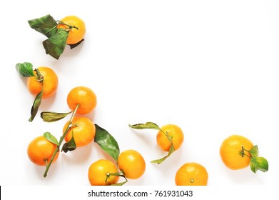 Fruit mock-up. Orange tangerines on a white background. Citrus on the table. Flat lay food styling. Top view stock photo, copy space
