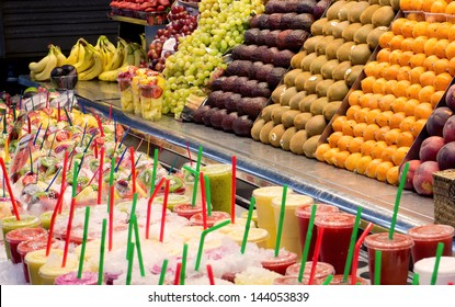 Fruit and natural juices on a market stall.