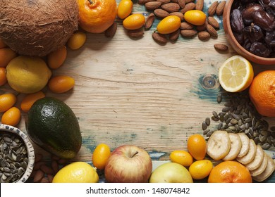 Fruit, nut and seed mix on rustic wooden table.