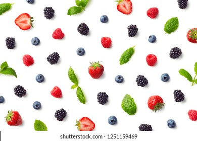 Fruit pattern of colorful berries and mint leaves isolated on white background. Top view. Flat lay