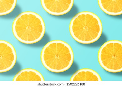 Fruit pattern. Colorful of fresh lemon texture slices on blue background. From top view. Photography collage. Minimal summer fruits pattern for blog or recipe book.